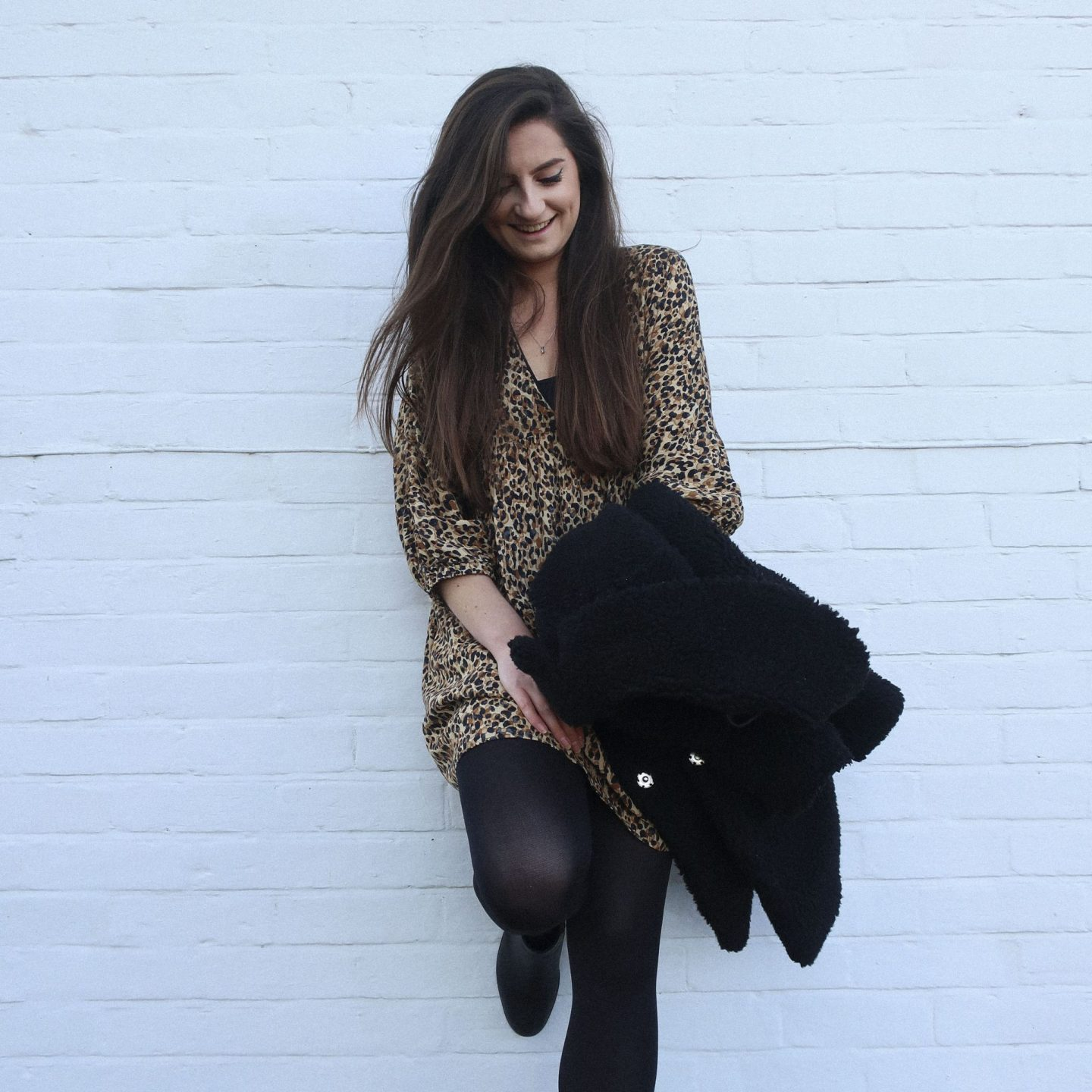 girl wearing leopard print dress smiling