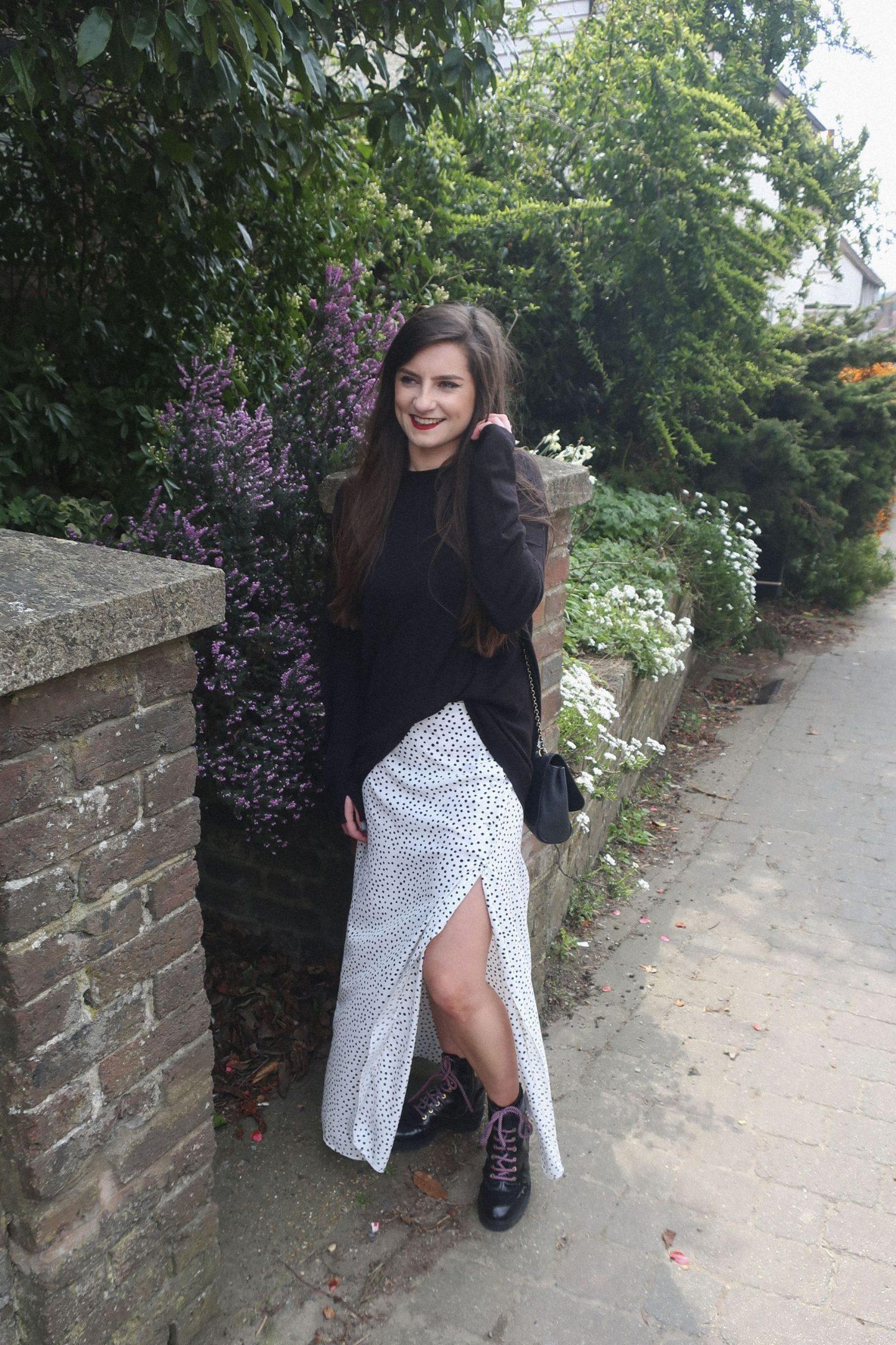girl with brown hair in polka dot skirt