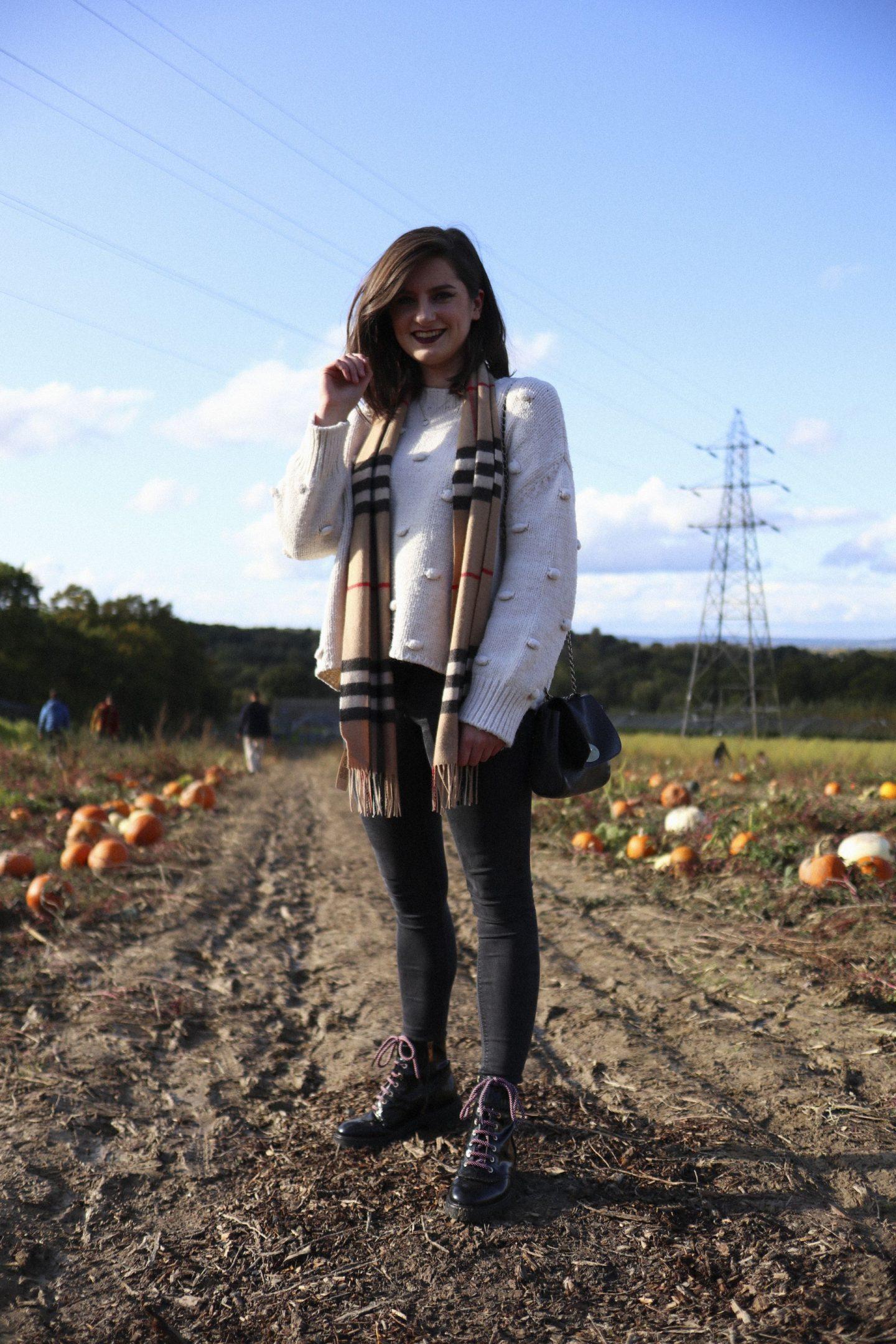 girl standing in pumpkin patch